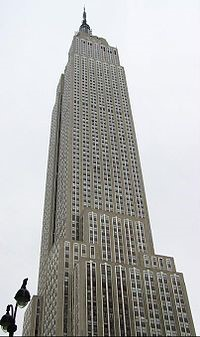 Photo of the Empire State Building, upper half, looking upward